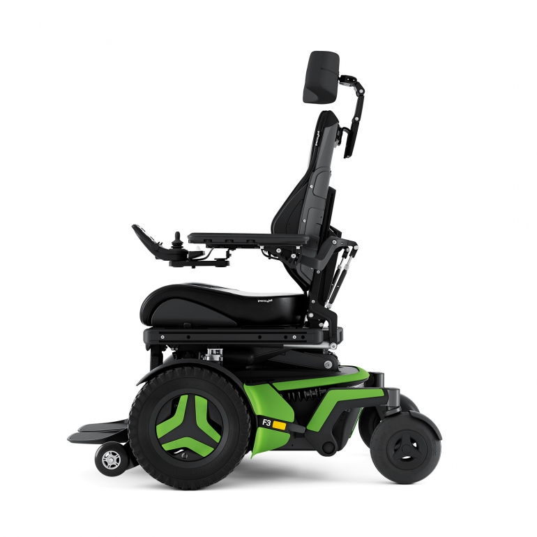 The F3 Corpus is shown from the side. It has bright green accents and black rehab seating, including a headrest.